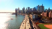 new day : NEW YORK CITY, USA - OCT 30, 2018: Timelapse view from above of downtown Manhattan with Brooklyn Bridge and traffic.
