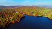 Aerial view of lake in Autumn with colorful foliage Stock Footage