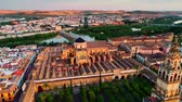 moslim : Drone view above the Great Mosque of C?rdoba or The Mosque?Cathedral of C?rdoba at sunset in Spain Stockvideo