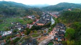 дома : Tulou aerial view in Fujian, China. The Fujian Tulou are houses of Chinese rural dwellings unique to the Hakka People. Стоковые видеозаписи