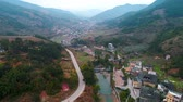 중국 : Tulou aerial view in Fujian, China. The Fujian Tulou are houses of Chinese rural dwellings unique to the Hakka People. 무비클립