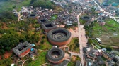 populair : Tulou aerial view in Fujian, China. The Fujian Tulou are houses of Chinese rural dwellings unique to the Hakka People. Stockvideo