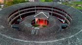 сельский : Tulou aerial view in Fujian, China. The Fujian Tulou are houses of Chinese rural dwellings unique to the Hakka People. Стоковые видеозаписи