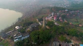 Çin : Ancient pagoda on mountain top aerial view in Neijiang, Sichuan, China Stok Video