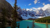 banff : Lake Moraine timelapse cloudscape in - sunny day with snow mountain and trees in Banff National Park, Canada. Stock Footage