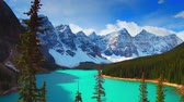 banff : Lake Moraine with trees in Banff National Park, Canada. Stock Footage