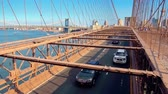 přeplněný : New York City - Sept 28, 2018: Heavy Traffic on Brooklyn Bridge at sunset. New York City  is the most populous city in the United States.