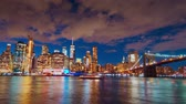 apartment buildings : New York City - Sept 28, 2018: Timelapse view of downtown waterfront at dusk. New York City  is the most populous city in the United States. Stock Footage