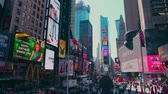 cartelera : New York City - Sept 28, 2018: Times square with crowded traffic billboard and people. New York City is the most populous city in the United States. Archivo de Video