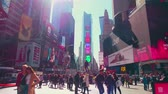 praça : New York City - Sept 28, 2018: Times square with crowded traffic billboard and people. New York City is the most populous city in the United States. Stock Footage