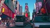 рекламный щит : New York City - Sept 28, 2018: Times square with crowded traffic billboard and people. New York City is the most populous city in the United States. Стоковые видеозаписи