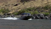 snake river canyon : Snake River, Hells Canyon in Idaho, turbo jet boats riding upstream Stock Footage