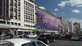 piata : BUCHAREST, ROMANIA - SEPTEMBER 05: High Traffic On Gheorghe Magheru Boulevard on September 05, 2013 in Bucharest, Romania. Situated downtown is one of the most expensive commercial street in the world Stock Footage