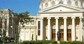 vintage : BUCHAREST, ROMANIA - APRIL 05, 2016: The Romanian Athenaeum George Enescu (Ateneul Roman) opened in 1888 is a concert hall in the center of Bucharest and a landmark of the Romanian capital city. Stock Footage