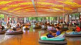 ter : BUCHAREST, ROMANIA - MAY 15, 2016: Children And Parents Having Fun On Bumper Cars Ride In Youths Public Park (Tineretului Park).