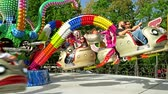 ter : BUCHAREST, ROMANIA - MAY 15, 2016: Children And Parents Having Fun In Youths Public Amusement Park Ride (Tineretului Park).