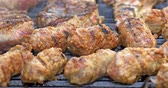 schab : Preparing Traditional Romanian Barbecue With Pork Meat Rolls (Mici Or Mititei) And Stakes