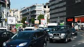 vintage : BUCHAREST, ROMANIA - MAY 19, 2015: Rush Hour Traffic In Union Square (Piata Unirii) one of the busiest and largest traffic intersections in downtown Bucharest city. Stock Footage