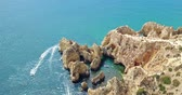 Алгарве : Aerial Footage From Flying Drone Of Calm Blue Water And Rocks Formations In Algarve Lagos, Portugal