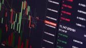 earn : Broker Trading Bitcoin Cryptocurrency On Exchange With Price Evolution Candle Chart Stock Footage