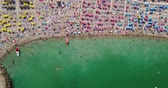 Aerial View From Flying Drone Of People Crowd Relaxing On Beach In Romania At The Black Sea