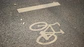 asphalt : Urban traffic scene with unrecognizable cyclists passing by a bicycle lane symbol