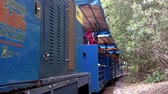 santuário : GOLD COAST, AUS -NOV 04 2014:Passengers rid on ridable miniature railway train in Currumbin Wildlife Sanctuary.The miniature railway has been operating since 1964.