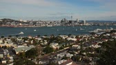 skytower : AUCKLAND, NZ - JUNE 07 2014:Auckland skyline.Auckland has been rated one of the worlds top 10 cities to visit by travel bible Lonely Planet. Stock Footage