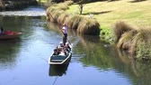 christchurch : People Punting on the Avon river Christchurch.It is an iconic tourist attraction of Christchurch, New Zealand. Stock Footage