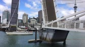 city : Yacht sail through Wynyard Crossing bridge.The 100m long bridge is able to lift to allow watercraft passage into the Viaduct Harbour area by lifting two 22m movable sections