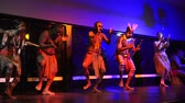 абориген : Yirrganydji Aboriginal men dance to Aboriginal music, during Aboriginal culture show in Queensland, Australia.