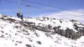 tongariro : People travel on the Ski lift of Mount Ruapehu in Tongariro National Park in the centre of New Zealands North Island Stock Footage