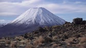 tongariro : Winter landscape of Mount Ngauruhoe  and Mount Tongariro in Tongariro National Park, It was used as a stand-in for the fictional Mount Doom in Peter Jacksons The Lord of the Rings film trilogy. Stock Footage