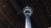 skytower : Auckland Sky Tower at night.Its 328 M (1,076 ft) tall from ground level to the top of the mast, making it the tallest free-standing structure in the Southern Hemisphere. Stock Footage