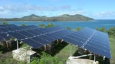 solar energy power : Solar PV modules on remote Island in Fiji. Fiji Sustainable Energy goals include sourcing more than 80% of the countrys electricity from renewable energies by 2020, and 100% by 2030. Stock Footage