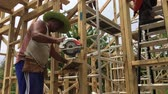 dekarz : Cook Islanders building a new home in Rarotonga island Cook Islands.
