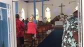 polinésia : Cook Islanders pray at Ekalesia Titikaveka - Cook Islands Christian Church Rarotonga.94% of Cook Islanders (14,974) associated themselves with a faith.The Cook Islands Christian Church (CICC) dominant with 49% (7,356) members.