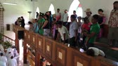 tapu : Cook Islanders pray at CICC church.94% of Cook Islanders (14,974) associated themselves with a faith.The Cook Islands Christian Church (CICC) dominant with 49% (7,356) members. Stock Footage