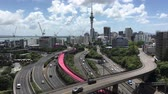 skytower : Panoramic urban aerial landscape view of traffic on Auckland city motorway. It is the most populous urban area in New Zealand.