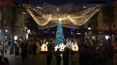 Australian people celebrate Christmas in Southbank at night, Brisbane City, Queensland, Australia