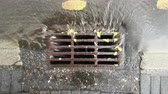 gutter system : rain water falling into sewerage after downpour from the top view Stock Footage