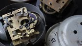Old vintage clock mechanism working, closeup shot with soft focus. Close up of a internal clock mechanism. Vintage Watch Gears Movement Macro.