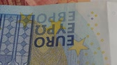 profit : Fragment of spining euros banknotes. Abstract background. Close up.