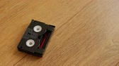 gravado : Mini DV cassettes falling on the floor, close up. Stock Footage