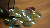arquivamento : Several useless digital discs falling out of the dustbin. Conceptual slow motion footage for technology development. Stock Footage
