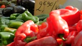 Fresh peppers with price on display in market. Stock Footage