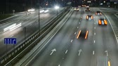 Time Lapse of Busy Freeway Traffic at Night in Vilnius, Lithuania. High-angle view from a bridge. Stock Footage