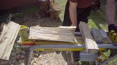 strength : Man chopping wood with a special device. Stock Footage