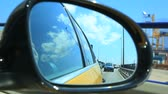 sideview : Sooting the road through the side mirror of a car in Barcelona