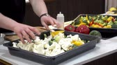 chef quipe : Chef mixes vegetables for cooking. Broccoli, cauliflower and pepper marinated in a tray on the table. HD video
